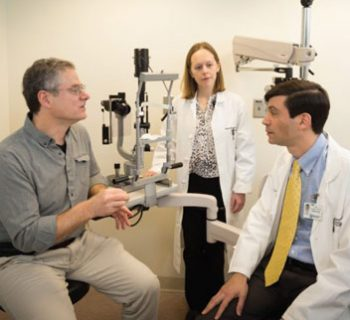 Eric Pierce MD PhD and Jason Comander MD PhD and Rachel Huckfeldt MD PhD in an eye exam room all in discussion